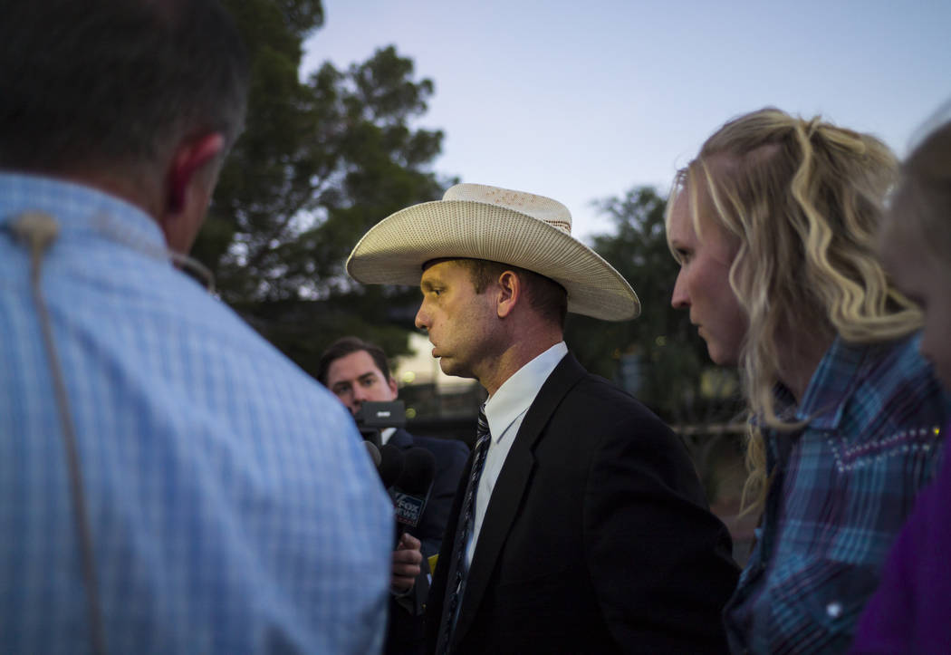 Ryan Bundy, son of Nevada rancher Cliven Bundy, leaves the Lloyd George U.S. Courthouse with his wife, Angela, in downtown Las Vegas on Tuesday, Nov. 14, 2017. Opening statements were delivered in ...