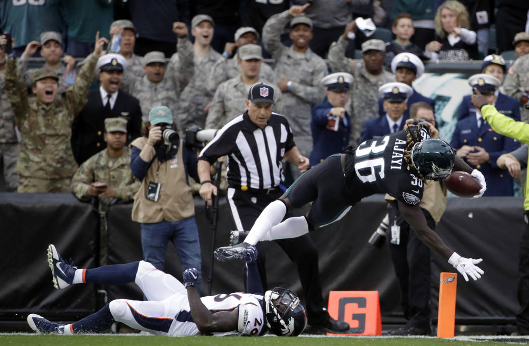Philadelphia Eagles' Jay Ajayi (36) scores a touchdown over Denver Broncos' Darian Stewart (26) during the first half of an NFL football game, Sunday, Nov. 5, 2017, in Philadelphia. (AP Photo/Matt ...