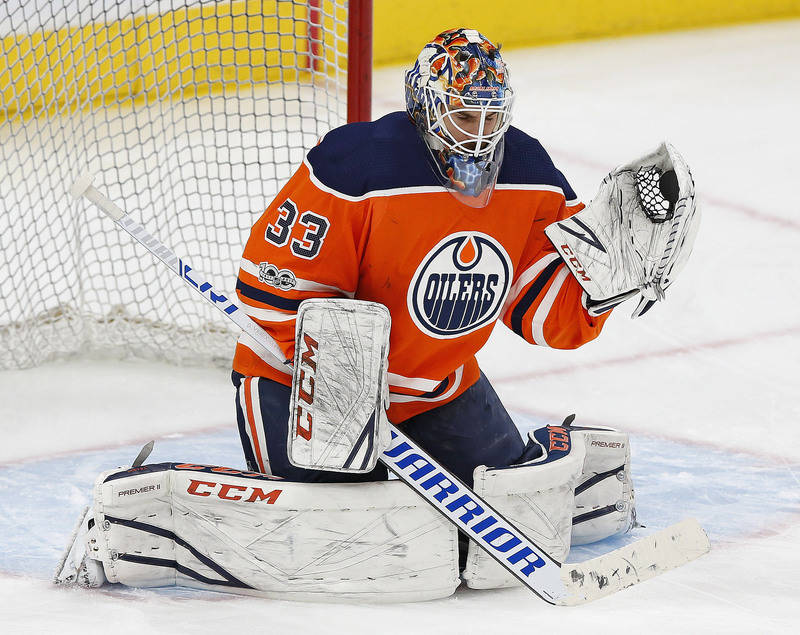 Nov 14, 2017; Edmonton, Alberta, CAN; Edmonton Oilers goaltender Cam Talbot (33) makes a save during warmup prior to the game against the Vegas Golden Knights at Rogers Place. (Perry Nelson-USA TO ...