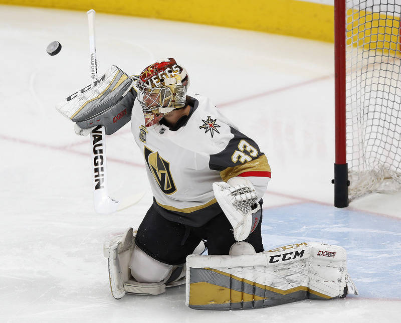 Nov 14, 2017; Edmonton, Alberta, CAN; Vegas Golden Knights goaltender Maxime Legace (33) makes a save during warmup prior to the game against the Edmonton Oilers at Rogers Place. (Perry Nelson-USA ...