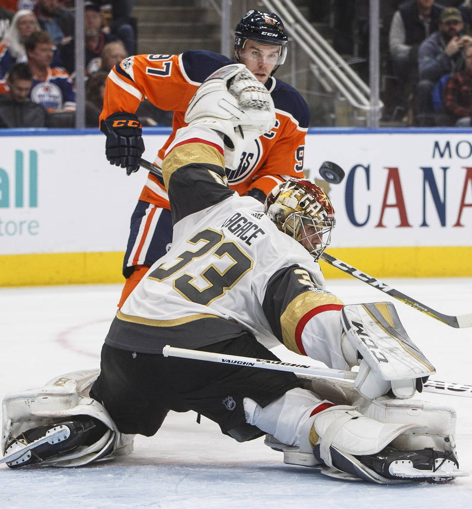 Vegas Golden Knights goalie Maxime Lagace (33) makes the save on Edmonton Oilers' Connor McDavid (97) during the second period of an NHL hockey game Tuesday, Nov. 14, 2017, in Edmonton, Alberta. ( ...