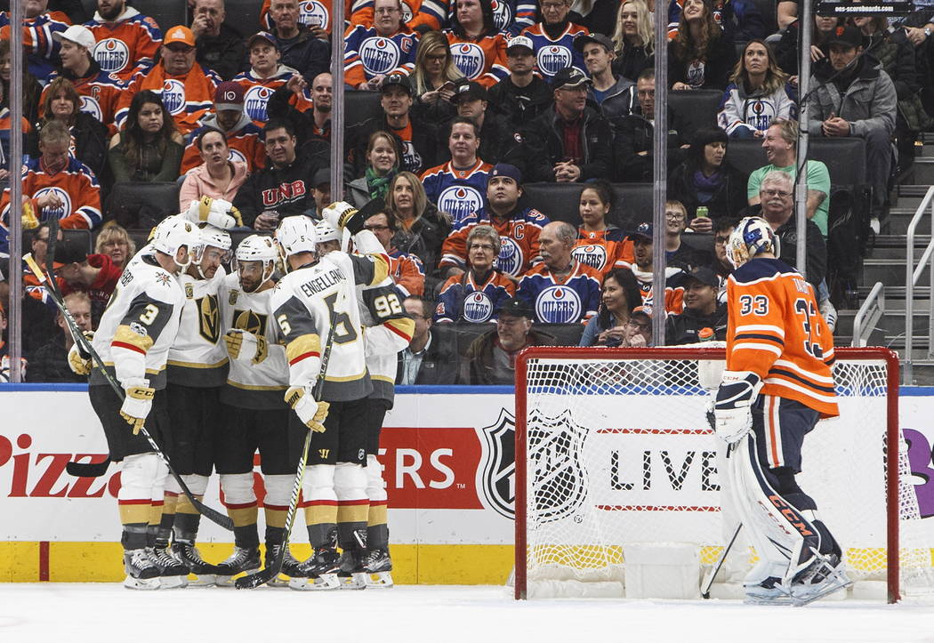 Vegas Golden Knights players celebrate a goal on Edmonton Oilers goalie Cam Talbot (33) during the second period of an NHL hockey game Tuesday, Nov. 14, 2017, in Edmonton, Alberta. (Jason Franson/ ...