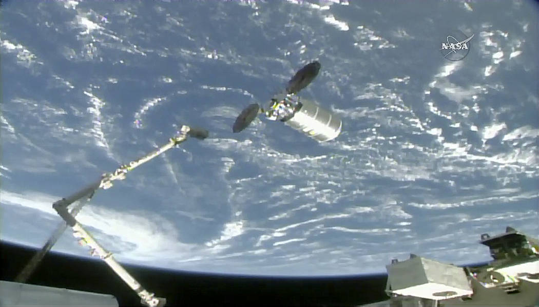 The International Space Station's robotic arm reaches to capture the Cygnus cargo spacecraft, Tuesday, Nov. 14, 2017, 260 miles (418 kms.) above the earth. The commercial supply ship arrived at th ...