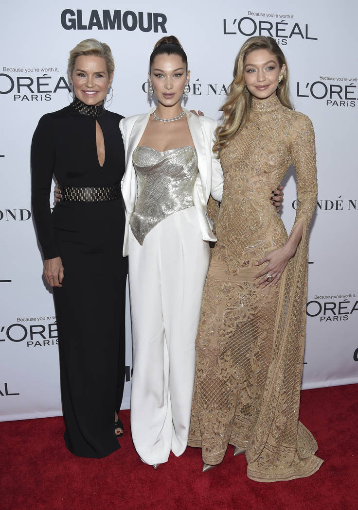 Yolanda Hadid, from left, Bella Hadid and Gigi Hadid attend the 2017 Glamour Women of the Year Awards at Kings Theatre on Monday, Nov. 13, 2017, in New York. (Photo by Evan Agostini/Invision/AP)