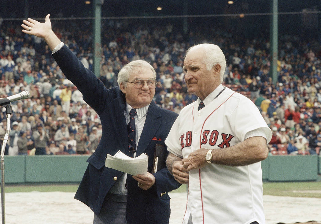In this May 21, 1988, file photo, the radio voice of the Boston Red Sox, Kent Coleman, left, presents former Red Sox second baseman Bobby Doerr to the crowd at Fenway Park during a ceremony to ret ...