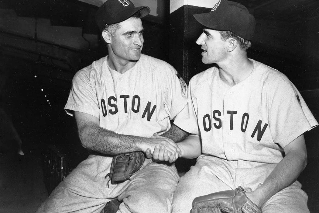 Bobby Doerr, left, Boston Red Sox second baseman, is congratulated by shortstop Johnny Pesky in the clubhouse at Yankee Stadium in the Bronx, N.Y., July 1, 1951.  Doerr has died at the age of 99.  ...