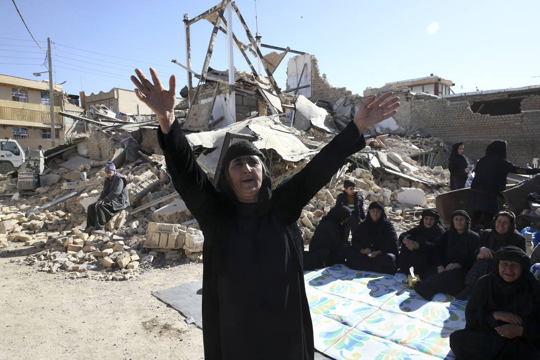A woman mourns at an earthquake site in Sarpol-e-Zahab in western Iran, Tuesday, Nov. 14, 2017. Rescuers are digging through the debris of buildings felled by the Sunday earthquake in the border r ...