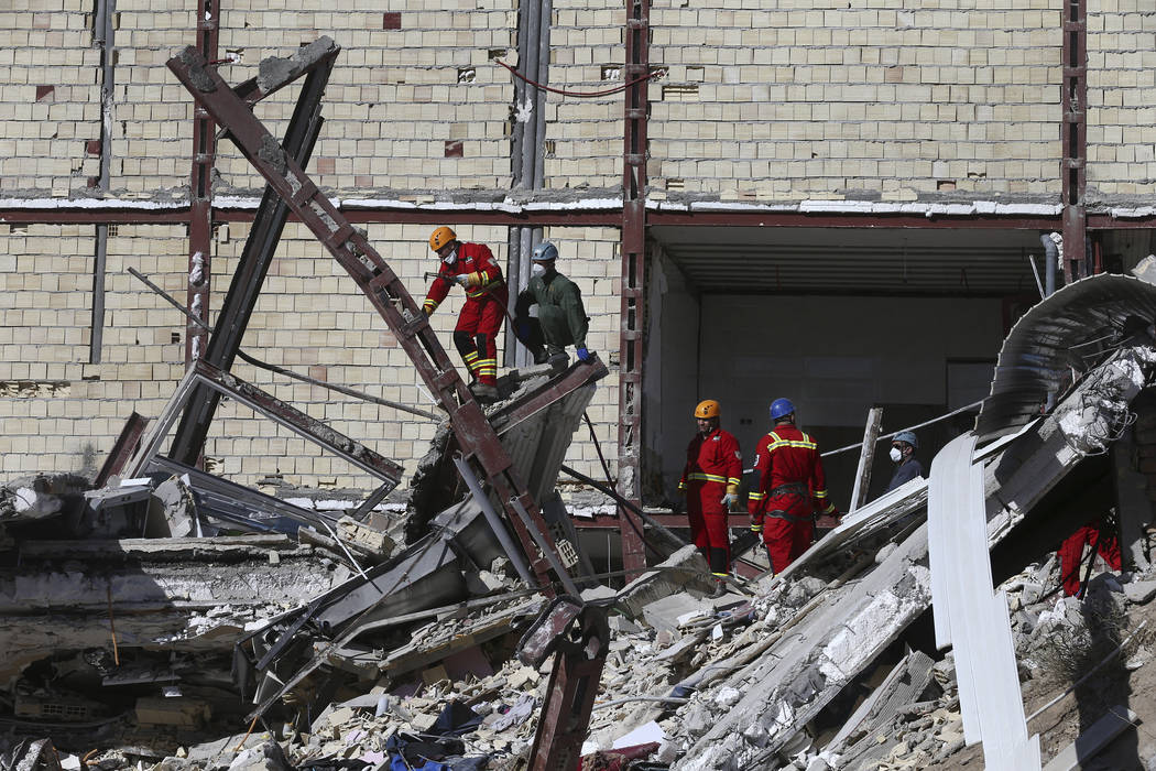 Rescuers work on the debris on the earthquake site in Sarpol-e-Zahab in western Iran, Tuesday, Nov. 14, 2017. Rescuers are digging through the debris of buildings felled by the Sunday earthquake i ...