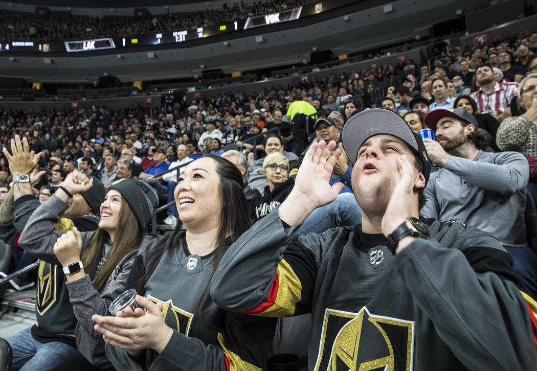 Zach Ramsey, right, Jessica Powman and Talisia Sandoval cheer for the Vegas Golden Knights during their first home preseason game with the Los Angeles Kings on Wednesday, Sept. 26, 2017, at T-Mobi ...