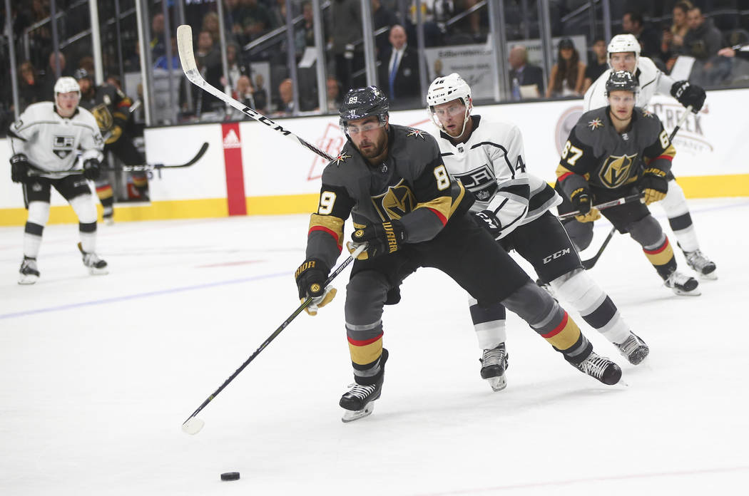 Golden Knights' Alex Tuch (89) goes after the puck against Los Angeles Kings' Spencer Watson (46) during an NHL preseason hockey game at T-Mobile Arena in Las Vegas on Tuesday, Sept. 26, 2017. Cha ...