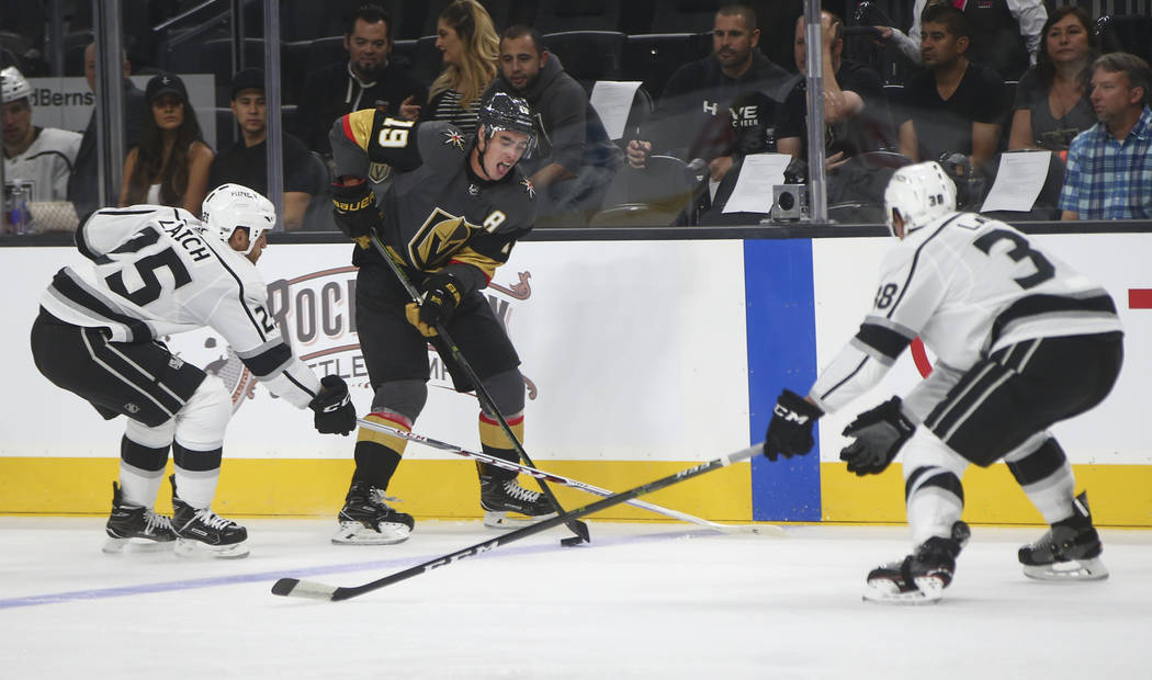 Golden Knights' Reilly Smith (19) tries to get past Los Angeles Kings Brooks Laich and Paul LaDue (38) during an NHL preseason hockey game at T-Mobile Arena in Las Vegas on Tuesday, Sept. 26, 2017 ...