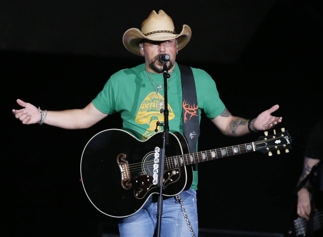 Jason Aldean addresses the crowd about the shooting in Las Vegas during his concert in Tulsa, Okla., Thursday, Oct. 12, 2017. The country star made an emotional return to the stage after canceling ...