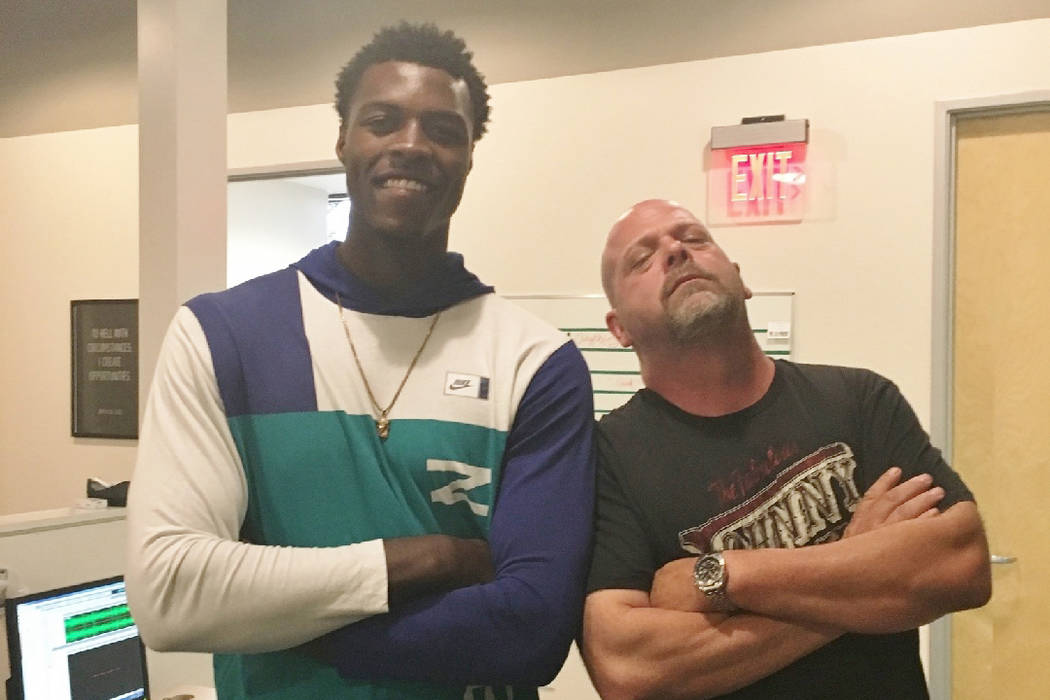 "Desmond Hudson, left, and Rick Harrison of TV's ""Pawn Stars"" pose at the KXNT 840-AM radio studio in Las Vegas. Hudson, a local homeless youth, has started his second season with the Highline Coll ..."