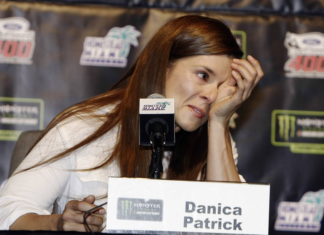Danica Patrick wipes away tears as he speaks with the media during a news conference before Sunday's NASCAR Cup Series auto race at Homestead-Miami Speedway in Homestead, Fla., Friday, Nov. 17, 20 ...