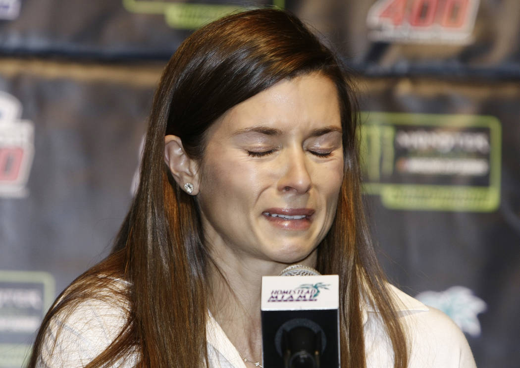Danica Patrick cries he speaks with the media during a news conference before Sunday's NASCAR Cup Series auto race at Homestead-Miami Speedway in Homestead, Fla., Friday, Nov. 17, 2017. Patrick wi ...