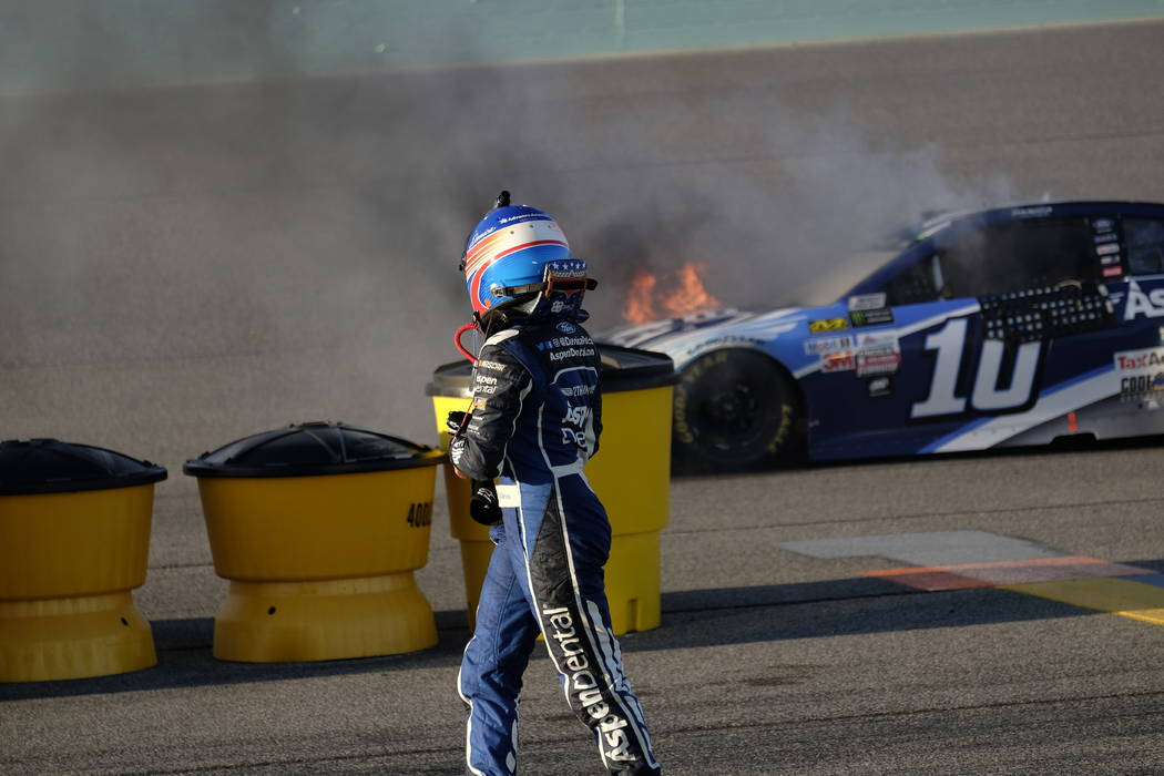 Danica Patrick looks back as her car catches fire after hitting the on turn two during the NASCAR Cup Series auto race at Homestead-Miami Speedway in Homestead, Fla., Sunday, Nov. 19, 2017 (AP Pho ...