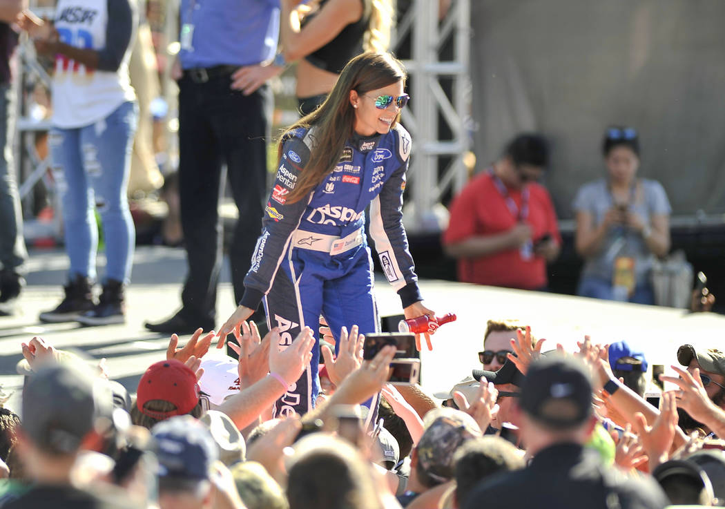 Danica Patrick. greets fans as she is introduced before a NASCAR Cup Series auto race at Homestead-Miami Speedway in Homestead, Fla., Sunday, Nov. 19, 2017. (AP Photo/Gaston De Cardenas)