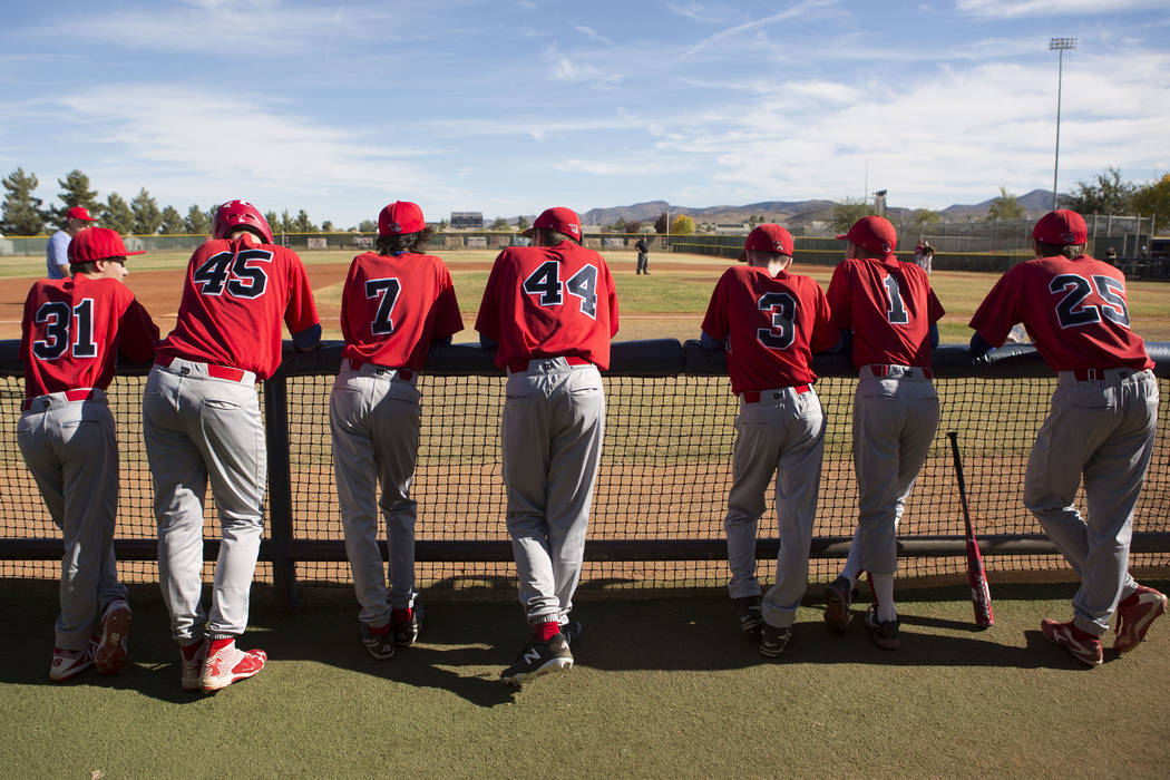 Players from the traveling youth baseball team Russian Wolves from Moscow hangout near the dugout during a game at Coronado High School in Henderson, Friday, Nov. 24, 2017. Bridget Bennett Las Veg ...