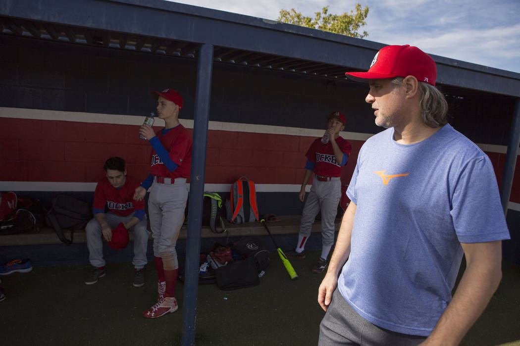 Players from the traveling youth baseball team Russian Wolves from Moscow hang in the dugout while their coach Sasha Volkov talks to them during a game at Coronado High School in Henderson, Friday ...