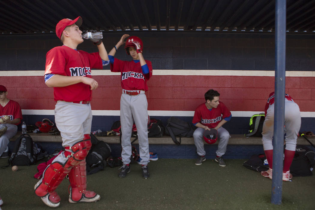 Players from the traveling youth baseball team Russian Wolves from Moscow hang in the dugout during a game at Coronado High School in Henderson, Friday, Nov. 24, 2017. Bridget Bennett Las Vegas Re ...