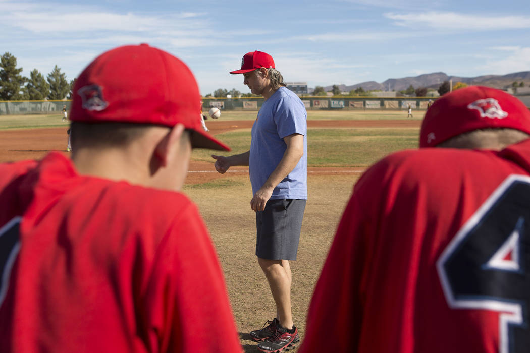 Coach Sasha Volkov, center, talks with his players from the traveling youth baseball team Russian Wolves from Moscow during a game at Coronado High School in Henderson, Friday, Nov. 24, 2017. Brid ...