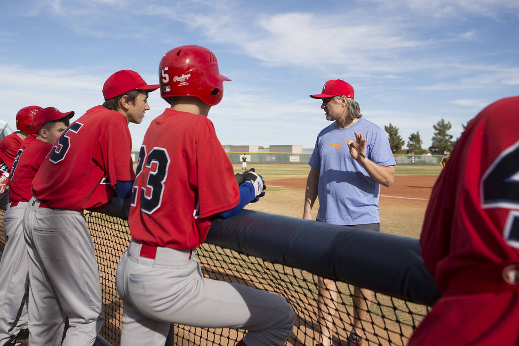 Coach Sasha Volkov talks with his players from the traveling youth baseball team Russian Wolves from Moscow during a game at Coronado High School in Henderson, Friday, Nov. 24, 2017. Bridget Benne ...