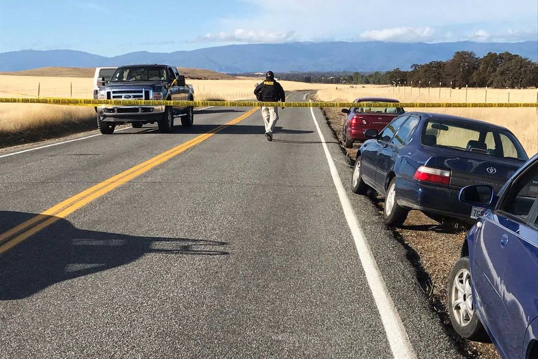 Crime tape blocks off Rancho Tehama Road leading into the Rancho Tehama subdivision south of Red Bluff, Calif., following a fatal shooting on Tuesday, Nov. 14, 2017. (Jim Schultz/The Record Search ...