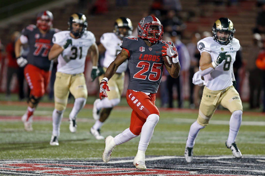 New Mexico running back Tyrone Owens (25) carries past the defense of Colorado State during the first half of an NCAA college football game in Albuquerque, N.M., Friday, Oct. 20, 2017. (AP Photo/A ...