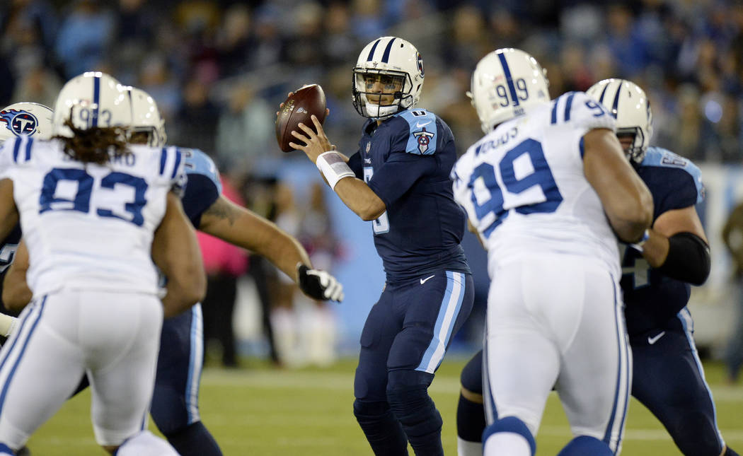 Tennessee Titans quarterback Marcus Mariota (8) passes against the Indianapolis Colts in the first half of an NFL football game Monday, Oct. 16, 2017, in Nashville, Tenn. (AP Photo/Mark Zaleski)