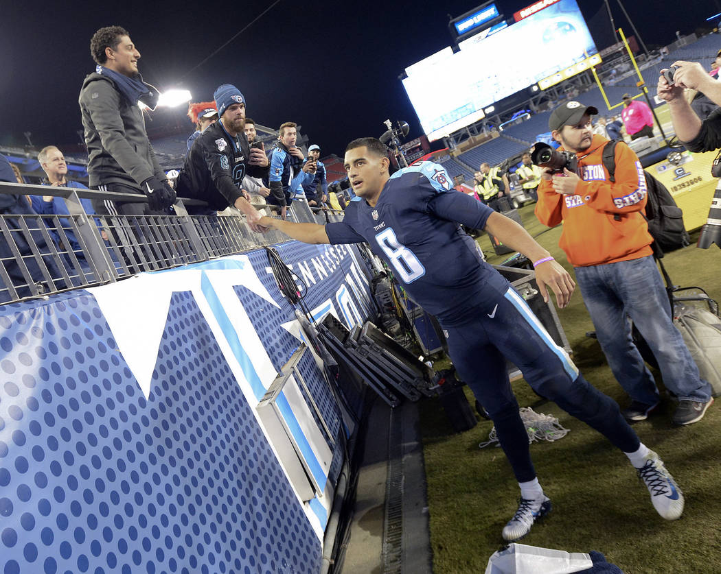 Tennessee Titans quarterback Marcus Mariota (8) greets fans as he leaves the field after an NFL football game against the Indianapolis Colts Monday, Oct. 16, 2017, in Nashville, Tenn. The Titans w ...