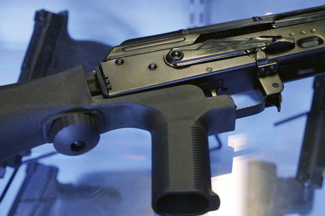 A device called a bump stock is attached to a semi-automatic rifle on Oct. 4, 2017. (Rick Bowmer/AP)
