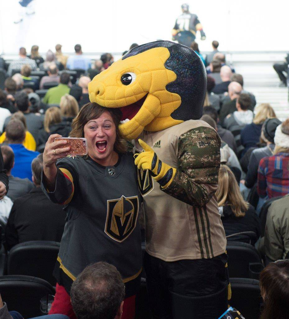 A fan takes a selfie with the Golden Knights mascot. (Tom Donoghue)