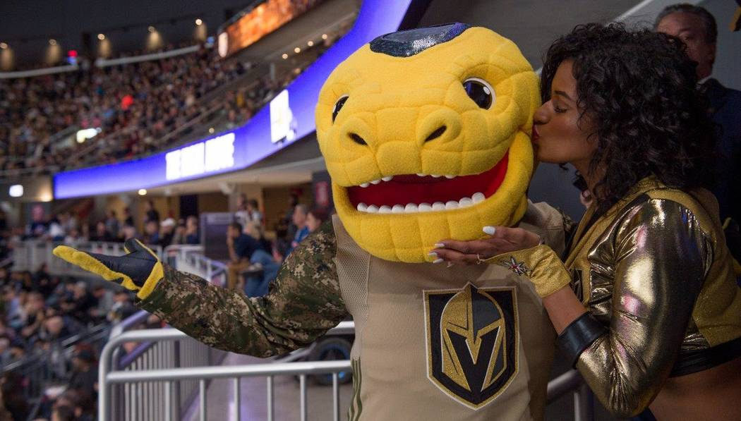 The Golden Knights mascot with a fan. (Tom Donoghue)