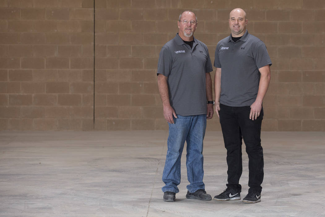 Co-Owners of Precision Tube Laser Barry Yost, left, and son Jordan Yost at their location where they will house the laser cutter in Las Vegas on Wednesday, Nov. 15, 2017.  Bridget Bennett Las Vega ...