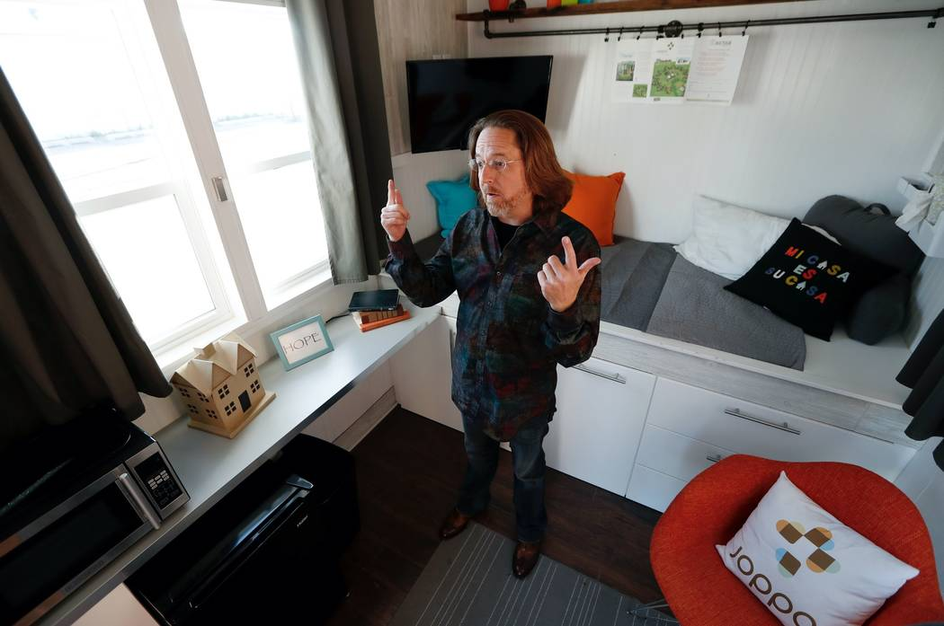 In this Wednesday, Oct. 11, 2017, photo, Joe Stevens stands in one of the tiny homes his group has built, in Des Moines, Iowa. Tiny homes have been promoted as the solution to all kinds of housing ...