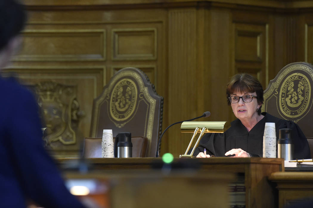 State Supreme Court Senior Justice Christine S. Vertefeuille questions attorney Josh Koskoff on arguments on whether gun maker Remington Arms should be held liable for the 2012 Newtown school mass ...