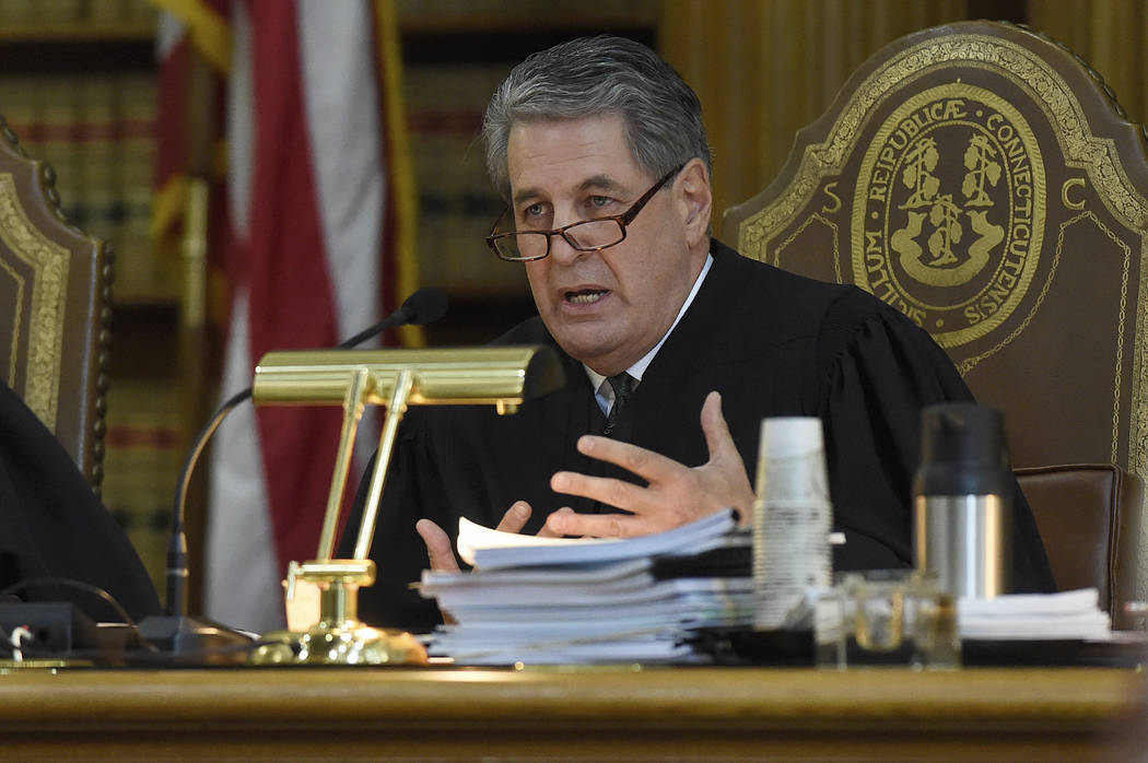 Justice Richard N. Palmer questions James Vogts, a lawyer for Remington Arms, during a hearing at the state Supreme Court in a lawsuit filed by Sandy Hook families against the company, in Hartford ...
