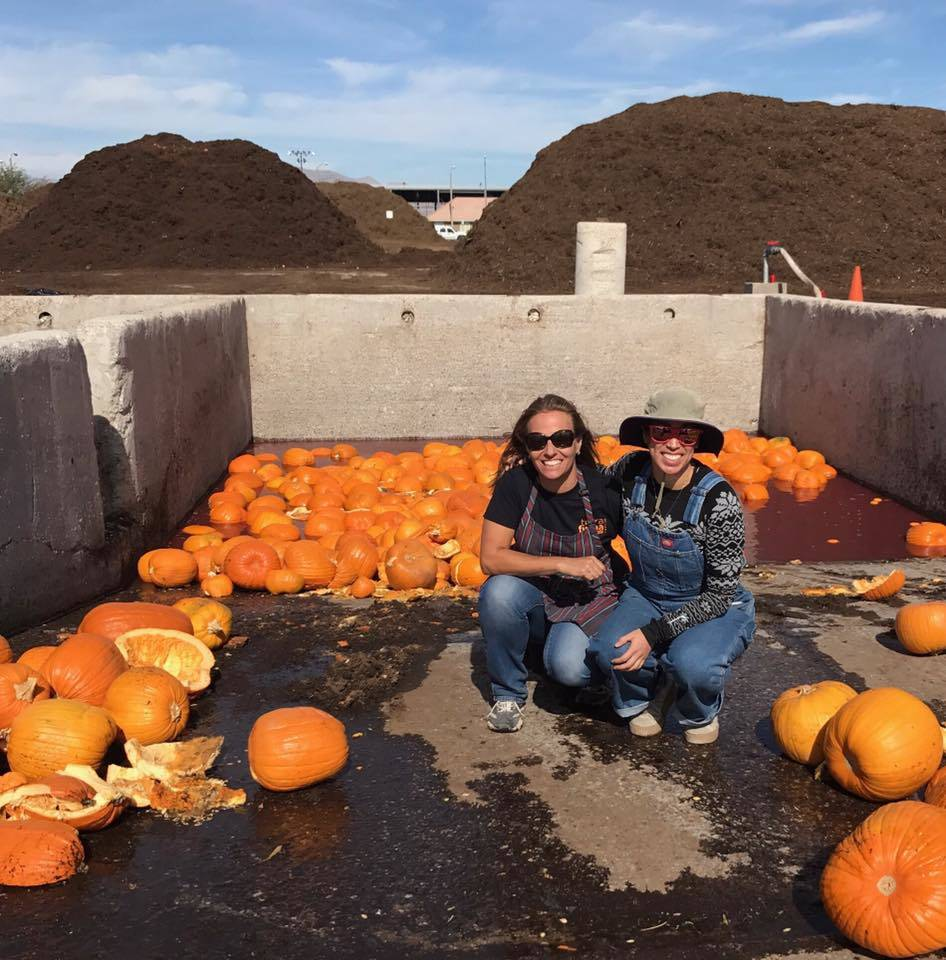 Tara Pike, left, and Rachel Lewison, left, post at Terra Firma Organics with just a few of the 29 tons of spoiled and leftover Halloween pumpkins they collected. (Southern Nevada Christmas Tree Re ...