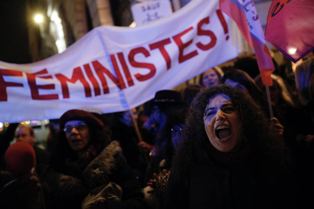 Activists hold a banner during a protest in Paris, Tuesday, Nov. 14, 2017. Justice Minister Nicole Belloubet provoked consternation and dismay among feminist groups by saying a legal minimum age o ...