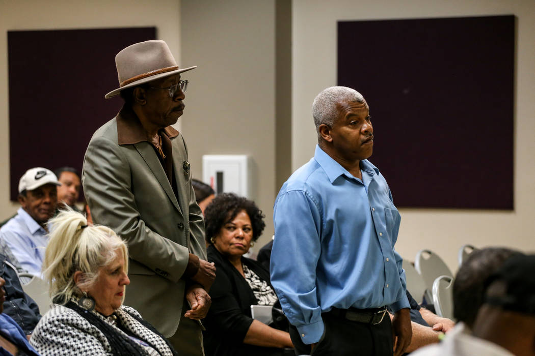 Joel Brown, 75, left, and Henry Thorns, 57, right, both of Las Vegas, wait in line to speak during a town hall meeting at the Pearson Community Center discussing the future of the Moulin Rouge sit ...