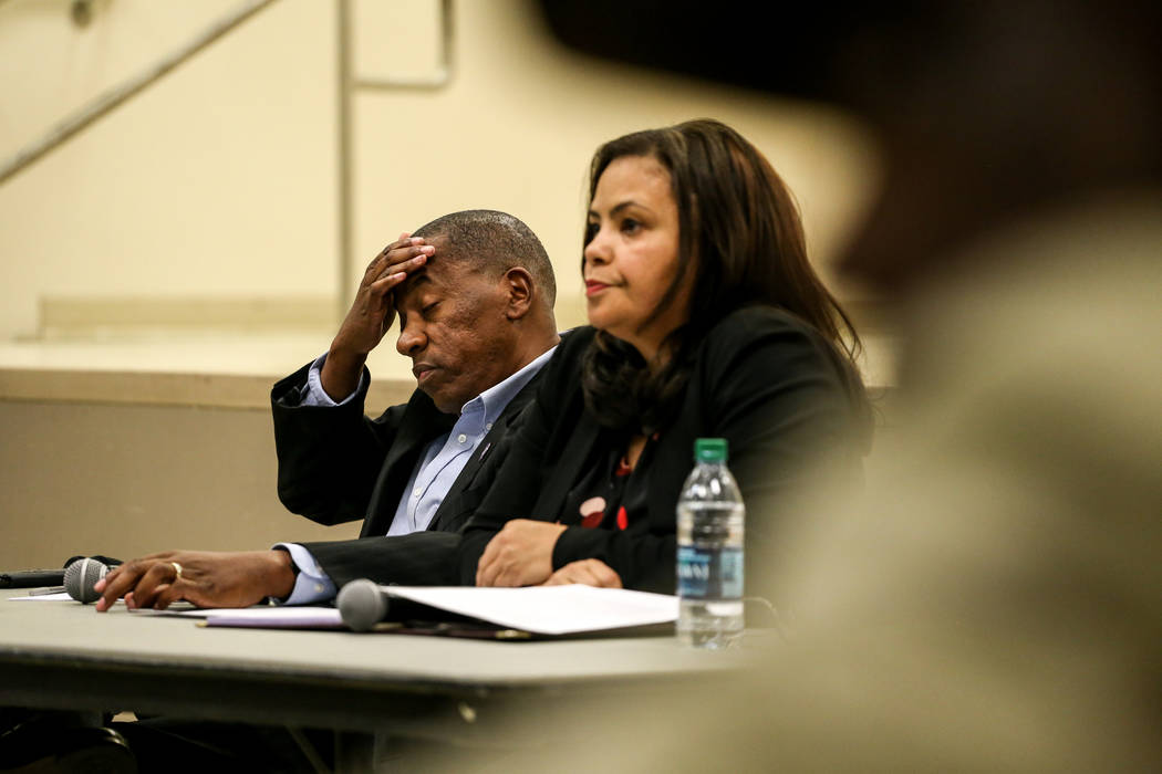 Clark County Commissioner Lawrence Weekly rubs his head as he listens to community members speak during a town hall meeting at the Pearson Community Center discussing the future of the Moulin Roug ...