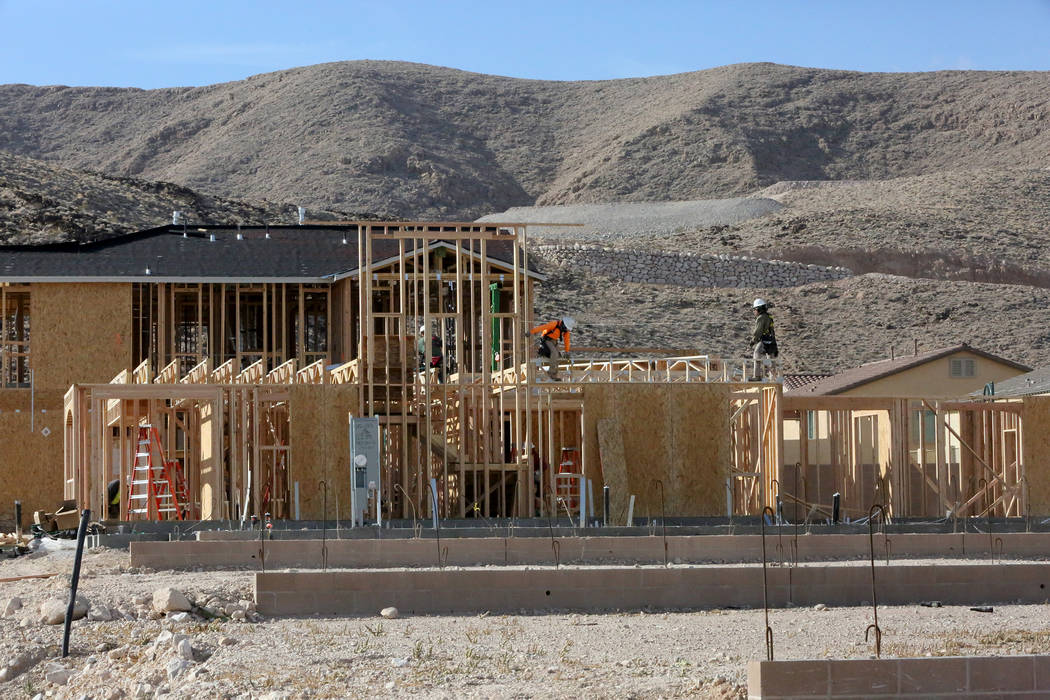 Construction workers put up new homes at Legends, a Lennar development in the Southern Highlands community on Nov. 3. (Michael Quine RJNewHomes.Vegas)
