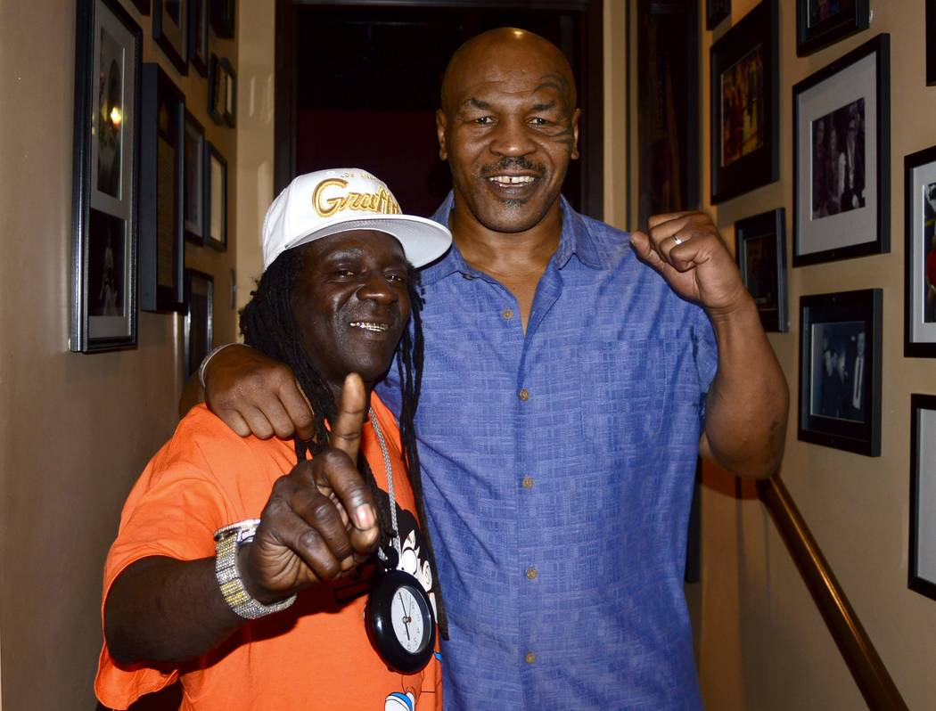"""Flavor Flav, left, is shown with Mike Tyson after Tyson's performance of """"Undisputed Truth: Round 2"""" at Brad Garrett's Comedy Club on Monday, Nov. 13, 2017. (Undisputed Truth -- Round 2)"""