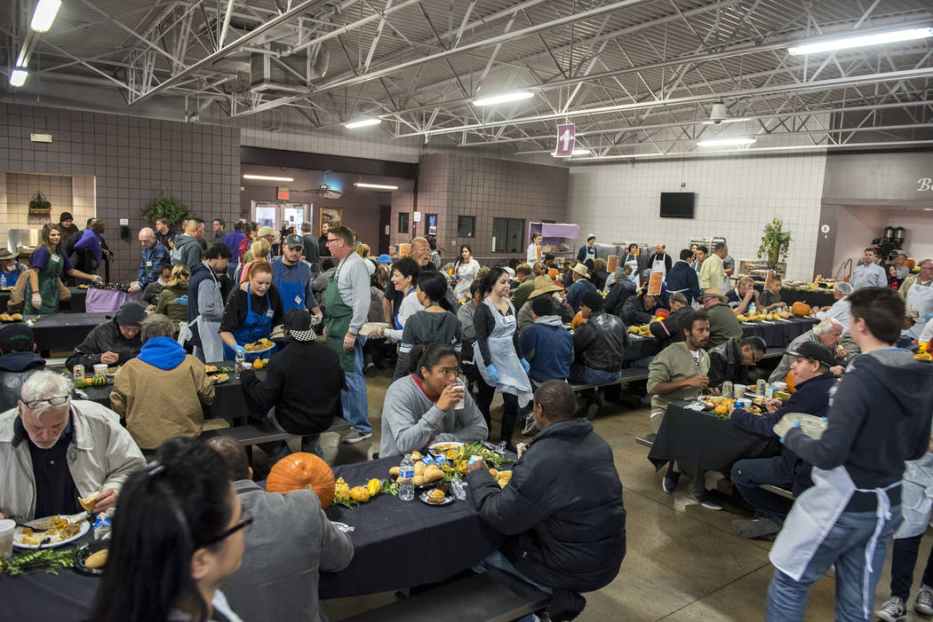 Owner of Lee's Liquor, Hae Un Lee, volunteers during Catholic Charities' annual Thanksgiving meal where about 175 volunteers help feed about 1,500 people from the Catholic Charities complex in Las ...