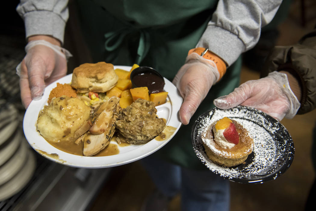 A traditional thanksgiving plate of food is shown during Catholic Charities' annual Thanksgiving meal where about 175 volunteers help feed about 1,500 people from the Catholic Charities complex in ...