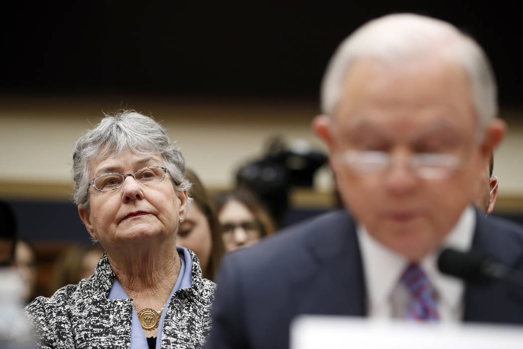 Mary Sessions, left, listens as her husband Attorney General Jeff Sessions speaks during a House Judiciary Committee hearing on Capitol Hill, Tuesday, Nov. 14, 2017 in Washington. (AP Photo/Alex B ...