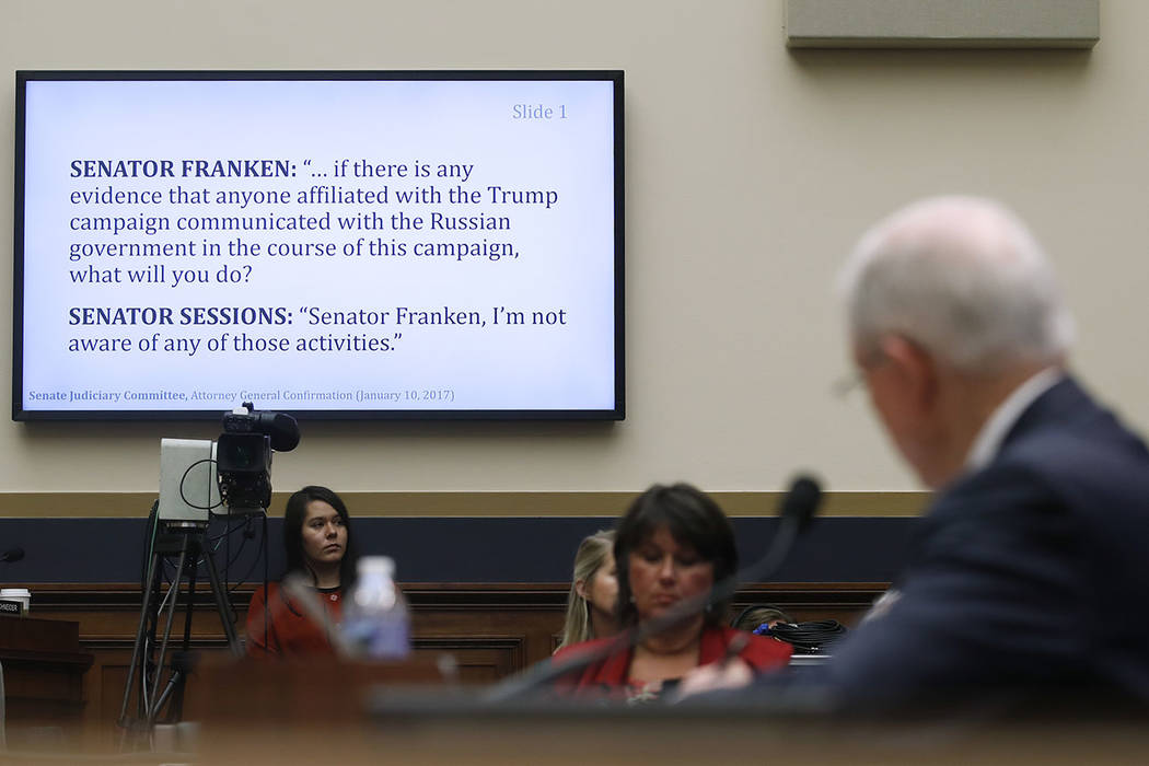 Attorney General Jeff Sessions, right, looks to a monitor displaying previous questioning by Sen. Al Franken, D-Minn., from Sessions' confirmation hearing on Jan. 10 2017, during a House Judiciary ...