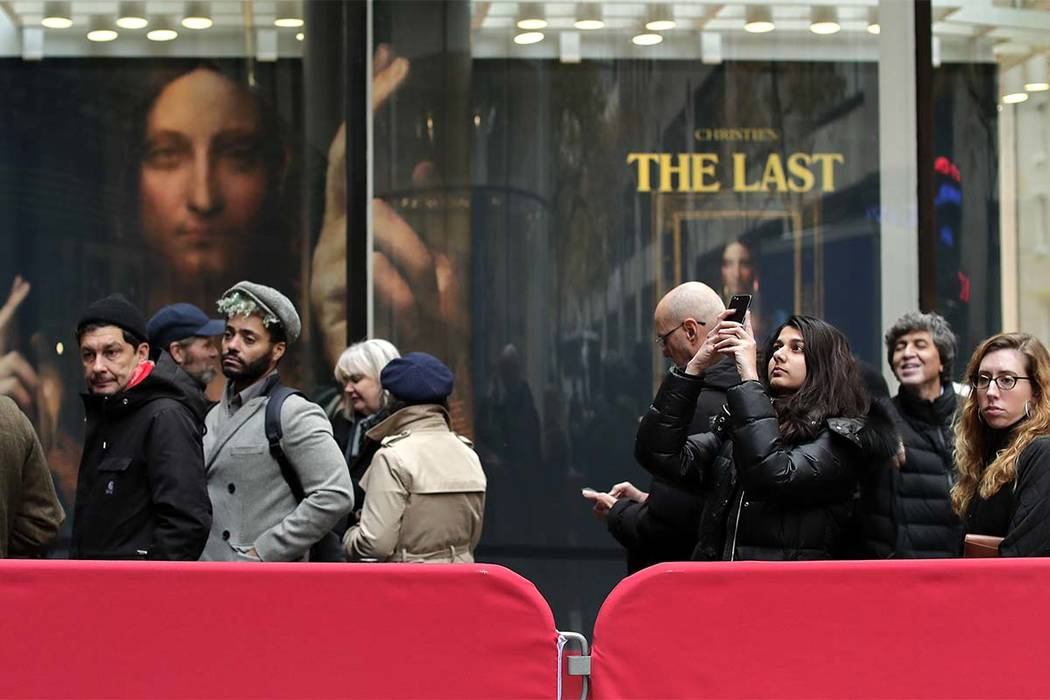 """Visitors to Christie's wait outside in a line to view Leonardo da Vinci's """"Salvator Mundi"""" on Tuesday, Nov. 14, 2017, in New York. The painting is expected to sell at auction for $100 million on W ..."""