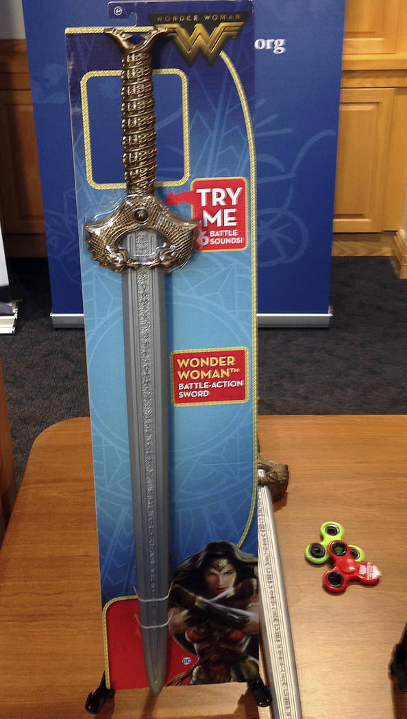 """A Wonder Woman """"battle sword"""" is displayed during a news conference Tuesday, Nov. 14, 2017, in Boston, where the child safety group World Against Toys Causing Harm, or W.A.T.C.H. ..."""