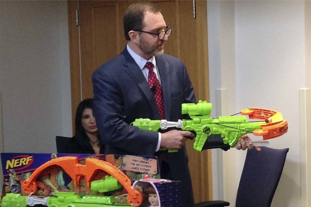 """James Swartz, director of World Against Toys Causing Harm, or WATCH displays Nerf's """"Zombie Strike"""" crossbow during a news conference Tuesday, Nov. 14, 2017, in Boston, where the child safety grou ..."""
